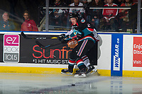 KELOWNA, CANADA - OCTOBER 13:  Lassi Thomson #2 of the Kelowna Rockets checks a player of the against the Tri-City Americans against the boards during first period on October 13, 2018 at Prospera Place in Kelowna, British Columbia, Canada.  (Photo by Marissa Baecker/Shoot the Breeze)  *** Local Caption ***