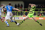 Forest Green Rovers Haydn Hollis goes in for a tackle with Colchester United's Luke Prosser(5) during the EFL Sky Bet League 2 match between Forest Green Rovers and Colchester United at the New Lawn, Forest Green, United Kingdom on 2 April 2018. Picture by Shane Healey.
