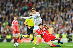 May 2, 2018 - Madrid, Spain - MADRID, SPAIN. May 1, 2018 - Ronaldo and Javi Martinez struggle for the ball. With a 2-2 draw against Bayern Munchen, Real Madrid made it to the UEFA Champions League Final for third time in a row. Kimmich and James scored for the german squad while Karim Benzema did it twice for los blancos. Goalkeeper Keylor Navas had a great night with several decisive interventions. (Credit Image: © VW Pics via ZUMA Wire)