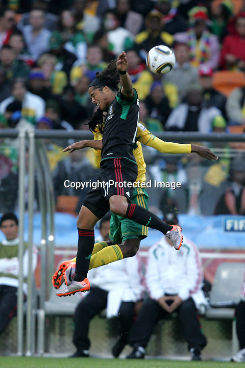 Giovani DOS SANTOS beats Siphiwe TSHABALALA to the high ball during the opening match ( match 1) of the FFA World Cup 2010 South Africa held at Soccer City in SOWETO, Johannesburg, South Africa on the 11th June 2010<br /> <br /> Photo by Ron Gaunt/SPORTZPICS