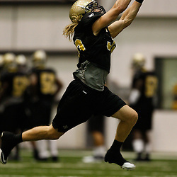 July 30, 2010; Metairie, LA, USA; New Orleans Saints safety Chris Reis (39) catches a pass during a training camp practice at the New Orleans Saints indoor practice facility. Mandatory Credit: Derick E. Hingle
