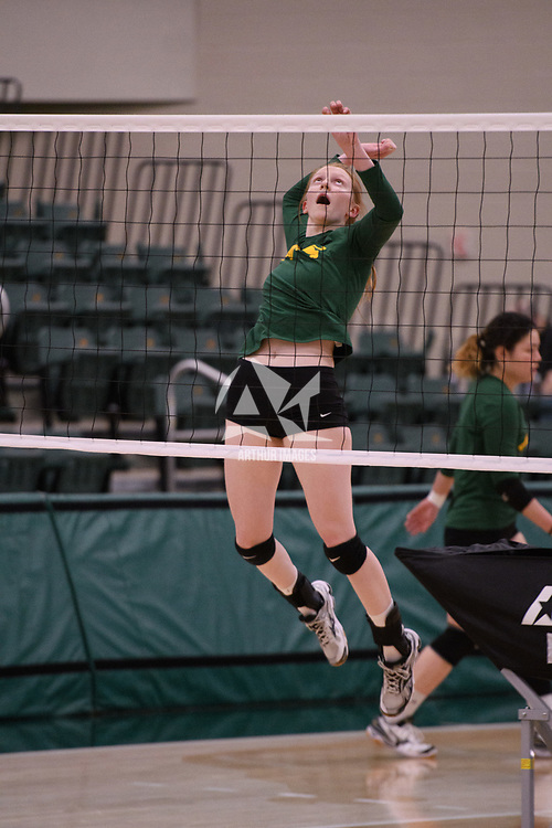 2nd year middle blocker Rebecca Wood (14) of the Regina Cougars in action during Women's Volleyball home game on January 12 at Centre for Kinesiology, Health and Sport. Credit: /Arthur Images 2018