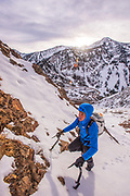 Alan Rousseau on the South Face of Mount Superior, Little Cottonwood Canyon, Utah. Low snow levels revealed a seldom climbed line of ice linking all the way to the summit ridge. 2500' of ice, snow and rock.