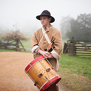 Sam Shepperd with the 24th Virginia Regiment waits to march into the Appomattox Court House National Historic Park early Thursday morning for the reenactment of the Battle of Appomattox Court House during the 150th anniversary of the end of the Civil War.