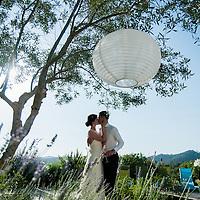 Irish couple kissing at Casa Felix, Olivella, Sitges, Barcelona, Spain.