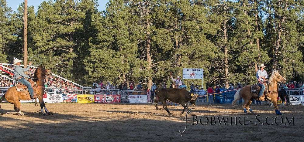 Header Brady Joseph and heeler Jorge Cruz Ibarra make their team roping run during the second performance of the Elizabeth Stampede on Saturday, June 2, 2018.