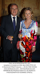 PAUL & ALISON MYNERS  at a reception in London on 29th April 2004.PTR 122