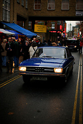 UK ENGLAND LONDON 4NOV12 - Street scene on busy Brick Lane in London's trendy east end. Oldtimer Audi car passes through crowds on Brick Lane.....jre/Photo by Jiri Rezac....© Jiri Rezac 2012