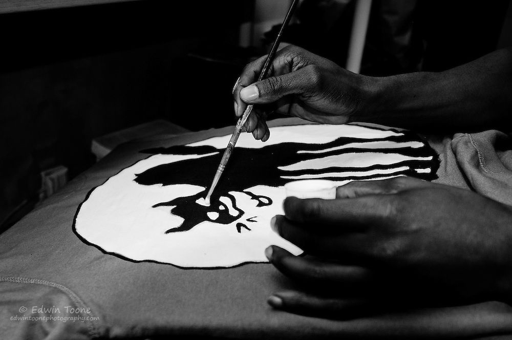 Jacinto spends every Sunday painting one of a kind designer t-shirts for his clothing company called Malabona.