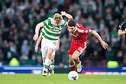 Aberdeen defender Anthony O'Connor (#15) and Celtic midfielder Stuart Armstrong (#14) tangle as they chase the ball during the Scottish Cup final match between Aberdeen and Celtic at Hampden Park, Glasgow, United Kingdom on 27 November 2016. Photo by Craig Doyle.