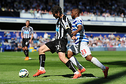 Newcastle United's Daryl Janmaat defends the ball from Queens Park Rangers' David Hoilett - Photo mandatory by-line: Dougie Allward/JMP - Mobile: 07966 386802 - 16/05/2015 - SPORT - football - London - Loftus Road - QPR v Newcastle United - Barclays Premier League