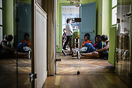 10042015. Paris. Les coiffeurs du 57 bd de Strasbourg récupèrent leurs titres de séjour en préfecture. Ils vont ensuite à l'Union départementale CGT pour célèbrer leur victoire pour prendre un verre. Ils finissent par retourner dans leur salon pour parader avec leurs papiers à Château d'eau devant les autre salons.