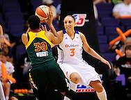 Sep 17 2011; Phoenix, AZ, USA; Phoenix Mercury guard Diana Taurasi (3) guards the Seattle Storm guard Tanisha Wright (30) during the first half at the US Airways Center.  The Mercury defeated the Storm 92 - 83. Mandatory Credit: Jennifer Stewart-US PRESSWIRE.