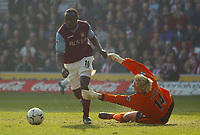 Aston Villa's Darius Vassell rounds Southampton's Antti Niemi