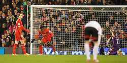 LONDON, ENGLAND - Wednesday, February 12, 2014: Liverpool's Kolo Toure looks dejected after scoring an own goal against Fulham during the Premiership match at Craven Cottage. (Pic by David Rawcliffe/Propaganda)