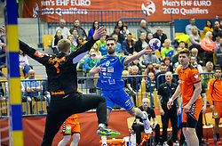 Bart Ravensbergen of Netherlands vs Blaz Janc of Slovenia during handball match between National teams of Slovenia and Netherlands in Qualifications of 2020 Men's EHF EURO, on April 14, 2019, in Arena Zlatorog, Celje, Slovenia. Photo by Vid Ponikvar / Sportida