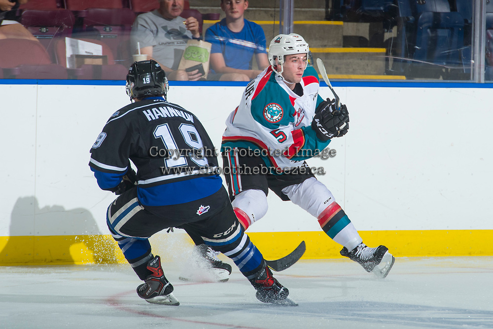 KELOWNA, CANADA - SEPTEMBER 2: Defenseman Konrad Belcourt #5 of the Kelowna Rockets passes the puck away from center Dante Hannoun #19 of the Victoria Royals on September 2, 2017 at Prospera Place in Kelowna, British Columbia, Canada.  (Photo by Marissa Baecker/Shoot the Breeze)  *** Local Caption ***