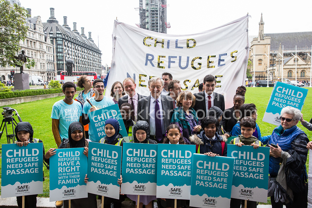 London, UK. 18 June, 2019. Lord Alf Dubs, Tim Farron and Barbara Winton join Safe Passage and children from the Hugh Myddelton Primary School at a demonstration in Parliament Square to demand that the Government resettle 10,000 unaccompanied refugee children over 10 years. As part of Lord Dubs' 'Our Turn' campaign, councils around the UK have already pledged places for over 1,100 children if the Government should make a new resettlement commitment.