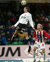 Fotball, 26. april 2003, Tippeligaen, Sogndal-Tromsø 3-1. Kristian Ystaas, Sogndal, header mens  Bjørn Johansen, Tromsø, står og ser på.