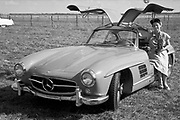 Gerry Lyons, Pete's mom, posing with MB 300SL Gullwing coupe at the 1955 Sebring race; photo by Ozzie Lyons