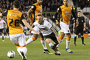 Derby forward Johnny Russell closes down the ball during the Sky Bet Championship match between Derby County and Hull City at the iPro Stadium, Derby, England on 5 April 2016. Photo by Aaron  Lupton.