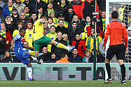 Picture by Paul Chesterton/Focus Images Ltd.  07904 640267.21/01/12.Anthony Pilkington of Norwich intercepts just before Chelsea's Florent Malouda can get his shot in during the Barclays Premier League match at Carrow Road Stadium, Norwich.