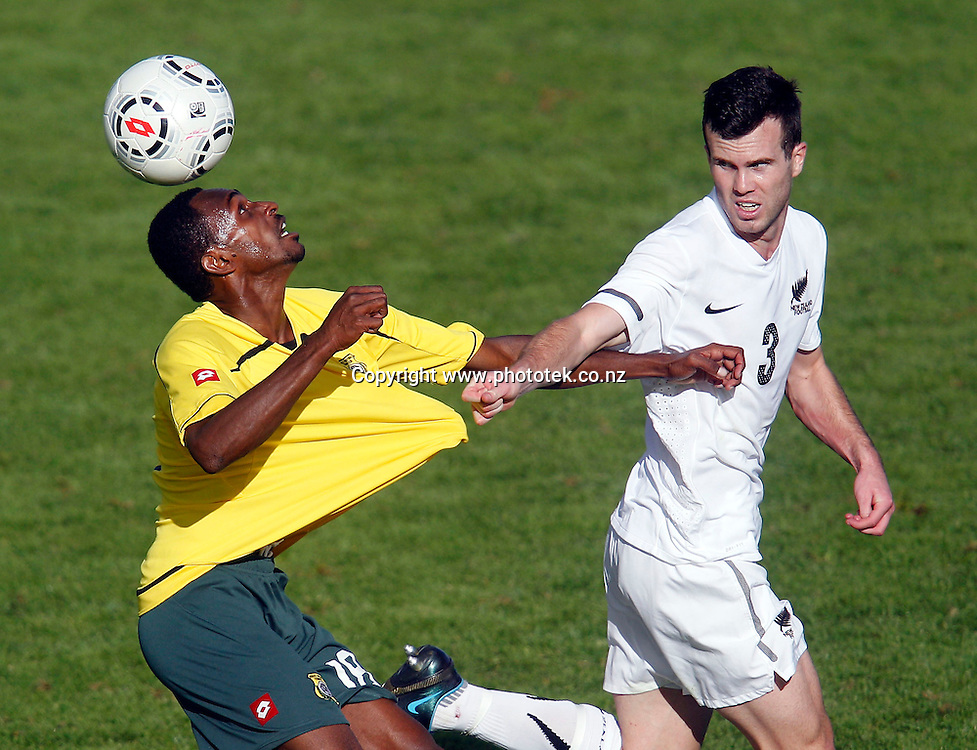 NZ's Ian Hogg tangle with Vanuatu's Bernard Daniel. OFC Men's Olympic Qualifier New Zealand 2012 Semi Final, New Zealand v Vanuatu, Owen Delany Park Taupo, Friday 23rd March 2012. Photo: Shane Wenzlick
