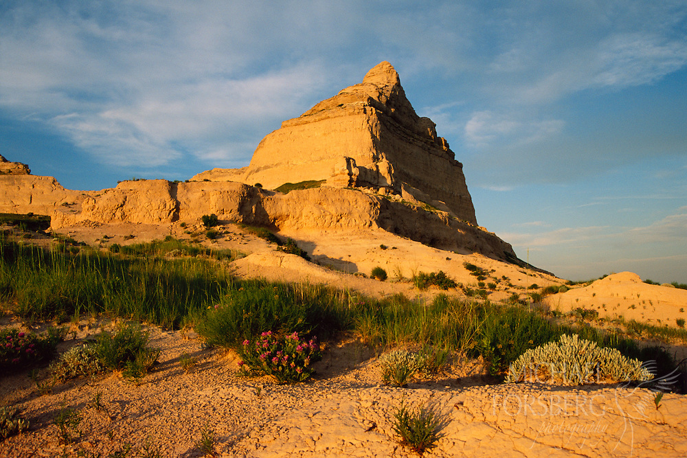 A striking rock formation in western Nebraska points to the sky, resembling a cathedral.