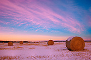 Bales and clouds at sunset<br /> Stony Plain<br /> Alberta<br /> Canada