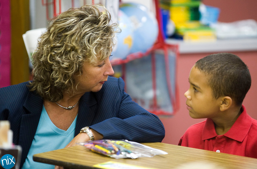 Kannapolis City Schools assistant superintendent Dr. Debra Morris talks with Jackson Park Elementary student Jaymere Suhocky while touring the schools on the first day of school in Kannapolis Wednesday morning. (Photo by James Nix).