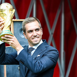 Former Germany star Philipp Lahm presents the World Cup to the crowd during the World Cup Final match between France and Croatia at Luzhniki Stadium on July 15, 2018 in Moscow, Russia. (Photo by Anthony Dibon/Icon Sport)