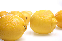 Close-up of lemons on white background