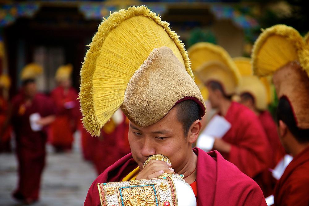 Monks with traditional Tibetan hats in Kathmandu, Nepal.