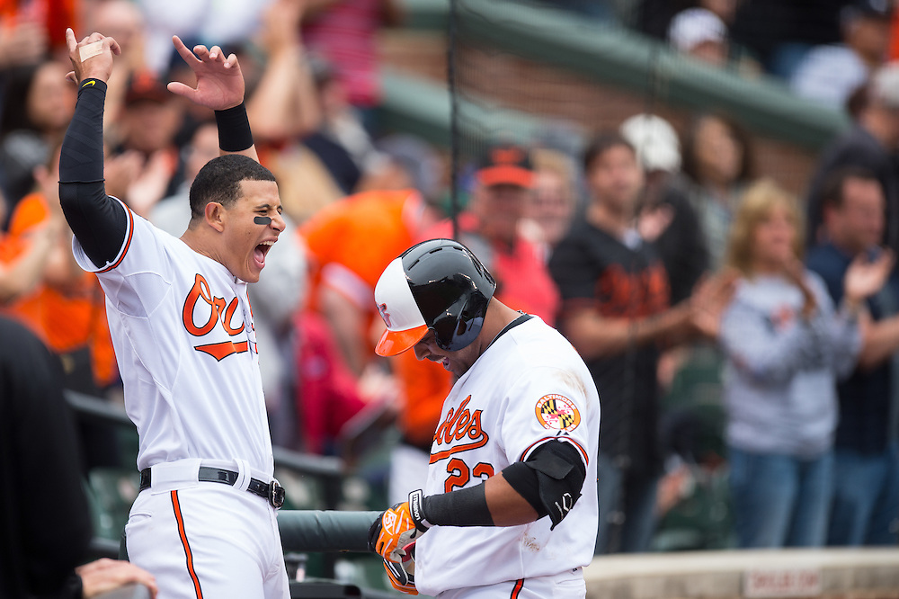 BALTIMORE, MD - MAY 14: Nelson Cruz #23 of the Baltimore Orioles celebrates a home run with team mate Manny Machado #13 of during the game against the Detroit Tigers at Oriole Park at Camden Yards on May 14, 2014 in Baltimore, Maryland. (Photo by Rob Tringali) *** Local Caption *** Nelson Cruz;Manny Machado