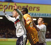 Dundee's Iain Davidson  and Colin Nish  challenge with Motherwell's Zaine Francis-Angol - Motherwell v Dundee at Fir Park in the Clydesdale Bank Scottish Premier League.. - © David Young - www.davidyoungphoto.co.uk - email: davidyoungphoto@gmail.com