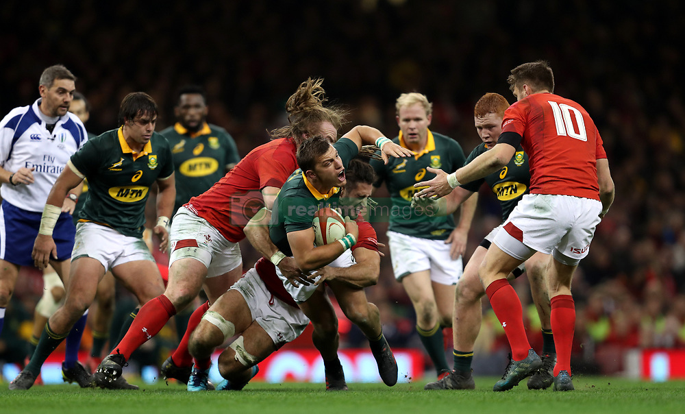 South Africa's Handre Pollard (centre) is tackled by Wales' Josh Navidi (back) and Kristian Dacey during the Autumn International at the Principality Stadium, Cardiff.