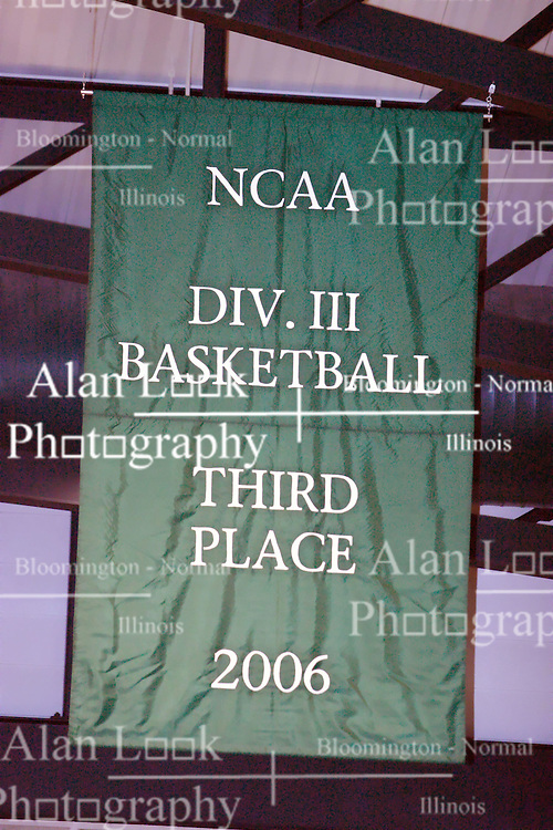16 December 2006: Illinois Weseyan unveils a banner marking last seasons 3rd place finish in the NCAA Division III mens basketball. The University of Chicago Maroons upset  the Illinois Wesleyan Titans 64 - 60 at the Shirk Center in Bloomington Illinois.<br />