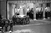 Funeral of President Childers.    (H62)..1974..20.11.1974..11.20.1974..20th November 1974..Following a period of lying in state, the remains of President Erskine Childers were removed today from Dublin Castle. The cortege would transfer the president to St Patrick's Cathedral where the funeral service would be held...Image shows the guard of honour carrying the Tricolour draped coffin of President Childers to the waiting gun carriage. The Government ministers are seen standing to the right of the coffin.