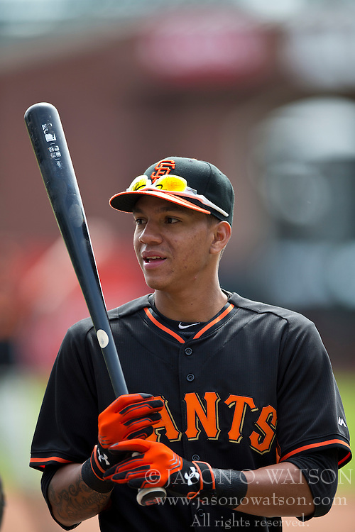 SAN FRANCISCO, CA - APRIL 26:  Ehire Adrianza #6 of the San Francisco Giants looks on during batting practice before the game at AT&T Park on April 26, 2014 in San Francisco, California. The San Francisco Giants defeated the Cleveland Indians 5-3.  (Photo by Jason O. Watson/Getty Images) *** Local Caption *** Ehire Adrianza
