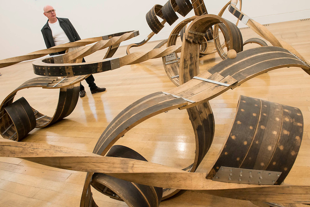 Tate Britain launches its major spring show, exhibiting the work of Turner Prize-winning artist Richard Deacon (b.1949 - pictured). It includes large sculptures made of twisted wood, metal, and ceramic such as: Fold 2012, a towering sculpture weighing over 12 tonnes and made of 60 shimmering glazed ceramic bricks; After 1998, a huge serpentine wooden structure that is over 9 metres at its longest point; and Out of Order 2003, a sprawling sculpture constructed from ribbons of steamed wood (pictured). The Tate Britain, London, UK 03 February 2014. Guy Bell, 07771 786236, guy@gbphotos.com
