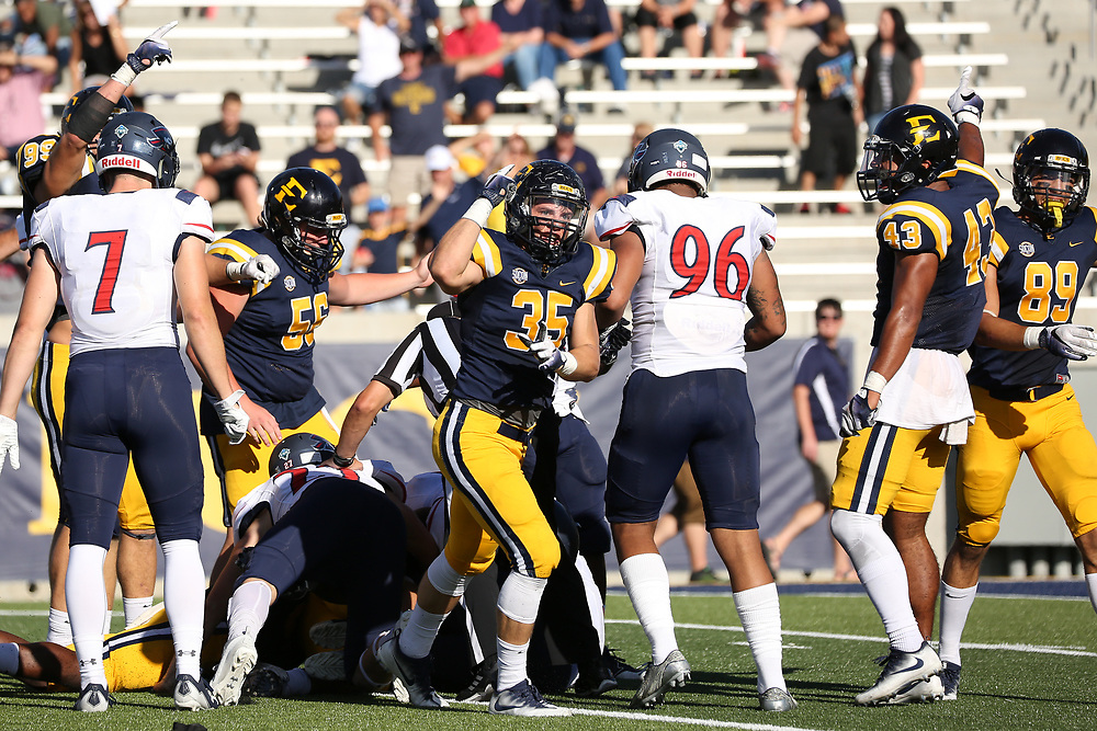 October 7, 2017 - Johnson City, Tennessee - William B. Greene Jr. Stadium: ETSU long snapper Adam Mullins (56), ETSU linebacker Christian Gibson (35), ETSU defensive back Titus Tucker (43), ETSU wide receiver Anthony Spagnoletti (89)<br /> <br /> Image Credit: Dakota Hamilton/ETSU