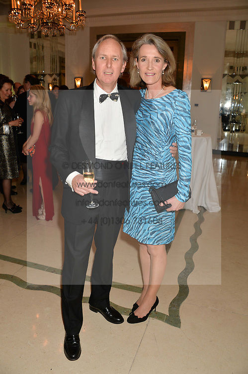 CHARLIE MAYHEW and CAROLINE MAYHEW at the Tusk Friends Dinner in aid of wildlife charity Tusk held at Claridge's, Brook Street, London on 11th March 2014.