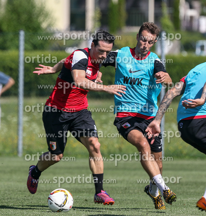21.07.2015, Trainingsplatz, Walchsee, AUT, FC Augsburg, Trainingslager, im Bild Pjotr Trochowski (FC Augsburg #36) im Zweikampf gegen Christoph Janker (FC Augsburg #16), // during a training session of the German Bundesliga Club FC Augsburg at the Trainingsplatz in Walchsee, Austria on 2015/07/21. EXPA Pictures © 2015, PhotoCredit: EXPA/ Eibner-Pressefoto/ Krieger<br /> <br /> *****ATTENTION - OUT of GER*****