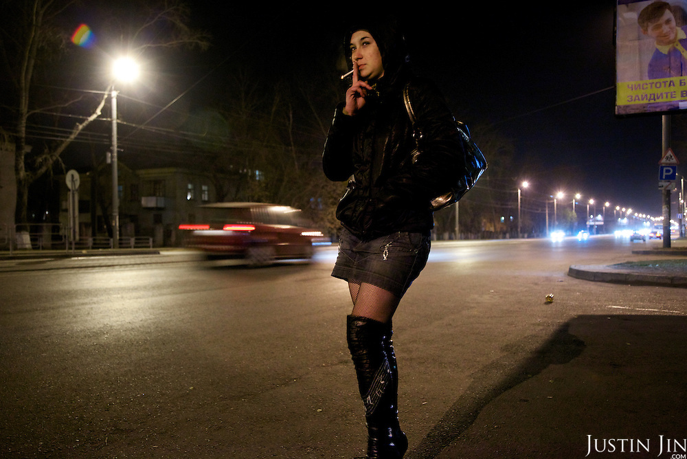 A sex worker who uses intravenous drugs waits for clients on the street in Chelyabinsk city.