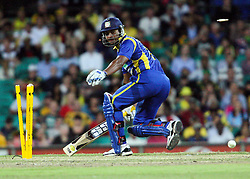 © Licensed to London News Pictures. 17/02/2012. Sydney Cricket Ground, Australia. Kumar Sangakkara looks back after narrowly making it as the stumps break after a direct hit during the One Day International cricket match between Australia Vs Sri Lanka. Photo credit : Asanka Brendon Ratnayake/LNP