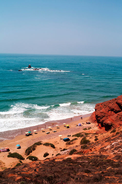 Legzira Beach, Sidi Ifni Province,Southern Morocco, 2016-06-04.<br /><br />Located between Mirleft and Sidi Ifni, Legzira is the most famous and unique beach in Morocco. <br /><br />The first arch which has been eroded out of the coastline by winds and the tide still stands and will not fail to impress, but the second natural rock arch formation which made the beach famous collapsed in September 2016.<br /><br />There are other natural arches and interesting rock formations dotted about the stretch of coastline between Sidi Ifni and Legzira.  It's possible to walk the mesmerising 10km stretch of coast from Legzira to Sidi Ifni, where you will be able to see another natural arch which is not accessible via the main beach. <br /><br />The main beach itself is an easy amble, with rugged, windswept coastline to admire as you walk your way up to the natural arch.