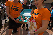 Cupcakes being given away as a publicity PR gimmick outside St Mary's Hospital, Paddington London, where media and royalists await news of Kate, Duchess of Cambridge's impending labour and birth to a baby boy. Some have been camping out for up to two weeks during a UK heatwave, having bagged the best locations where the heir to the British throne will eventually be shown to the waiting world.