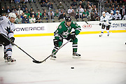 DALLAS, TX - OCTOBER 17:  Ray Whitney #13 of the Dallas Stars tries to control the puck against the San Jose Sharks on October 17, 2013 at the American Airlines Center in Dallas, Texas.  (Photo by Cooper Neill/Getty Images) *** Local Caption *** Ray Whitney