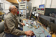 Systems Engineer Ken Bodensteiner works at a testing station at Softronics LTD in Marion on Monday, February 11, 2013.