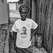 Community Health Worker wears a t shirt that mourns a dead colleague.  John Logan Town, Liberia.